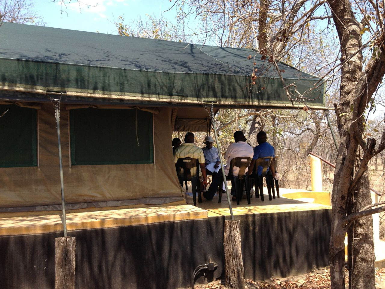 Small group discussion on the veranda of one of the accommodation tents.