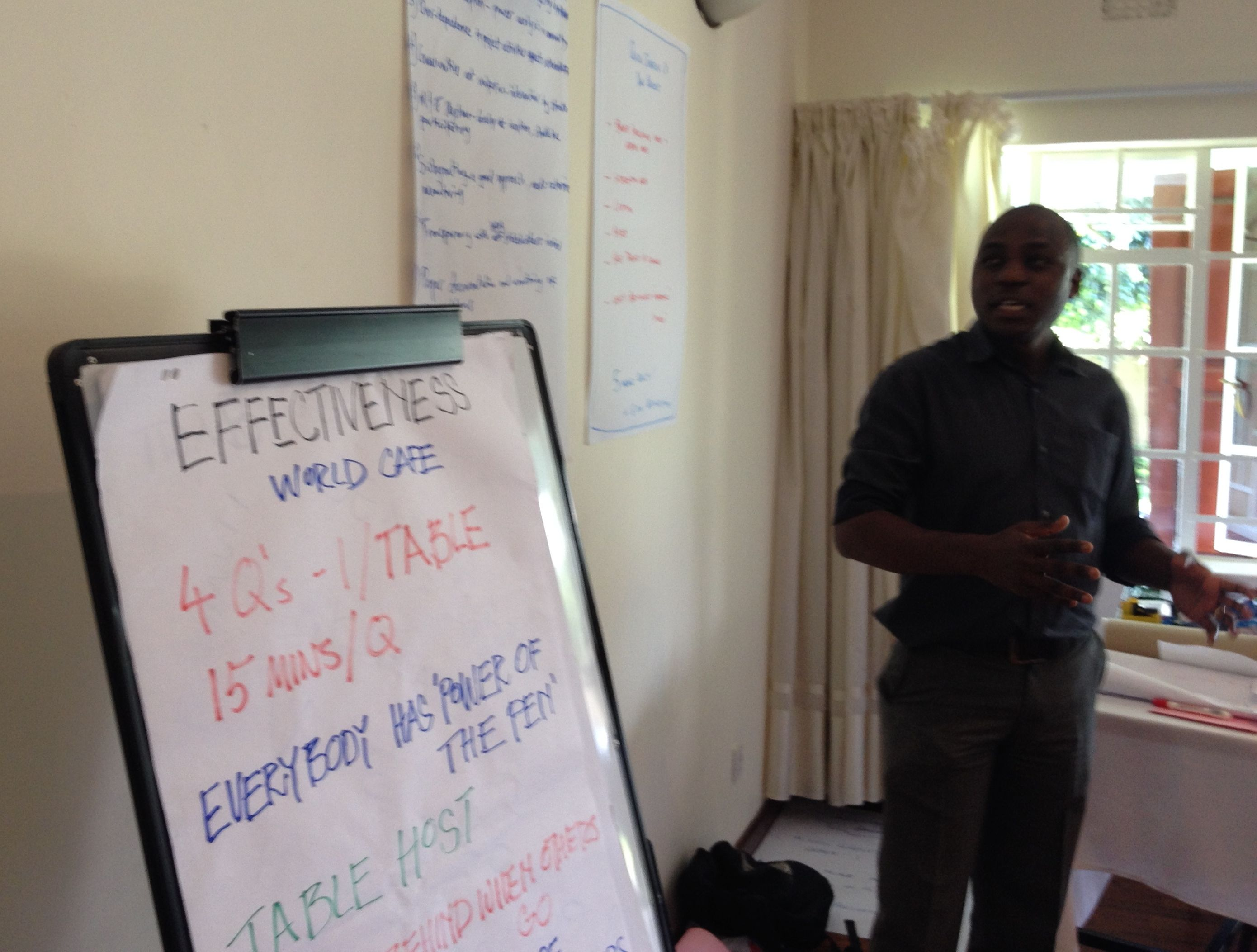 Tenthema (of the sugar out growers capacity building project) giving the discussion summary of the Effectiveness Successes World Cafe table.