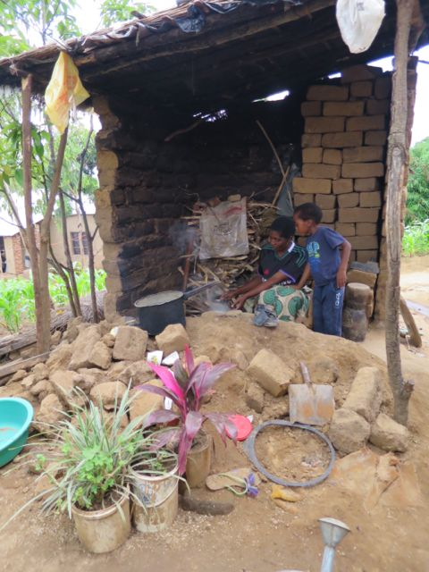 Ali's wife Mazie and son Emanual preparing food in their wrecked kitchen.